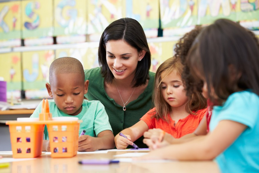 early intervention therapist helping classroom